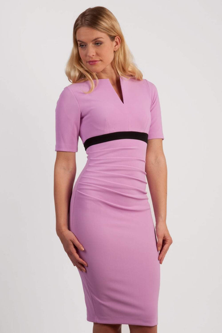 brunette model wearing diva catwalk nadia fitted dress with pencil pleated skirt with sleeves and rounded neckline with split in colour pearl violet front