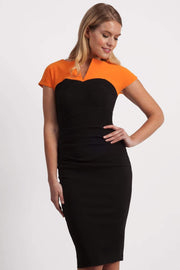 Model wearing the Diva Bryony Contrast dress with contrasting top and exposed zip at the back in black and sun orange front image