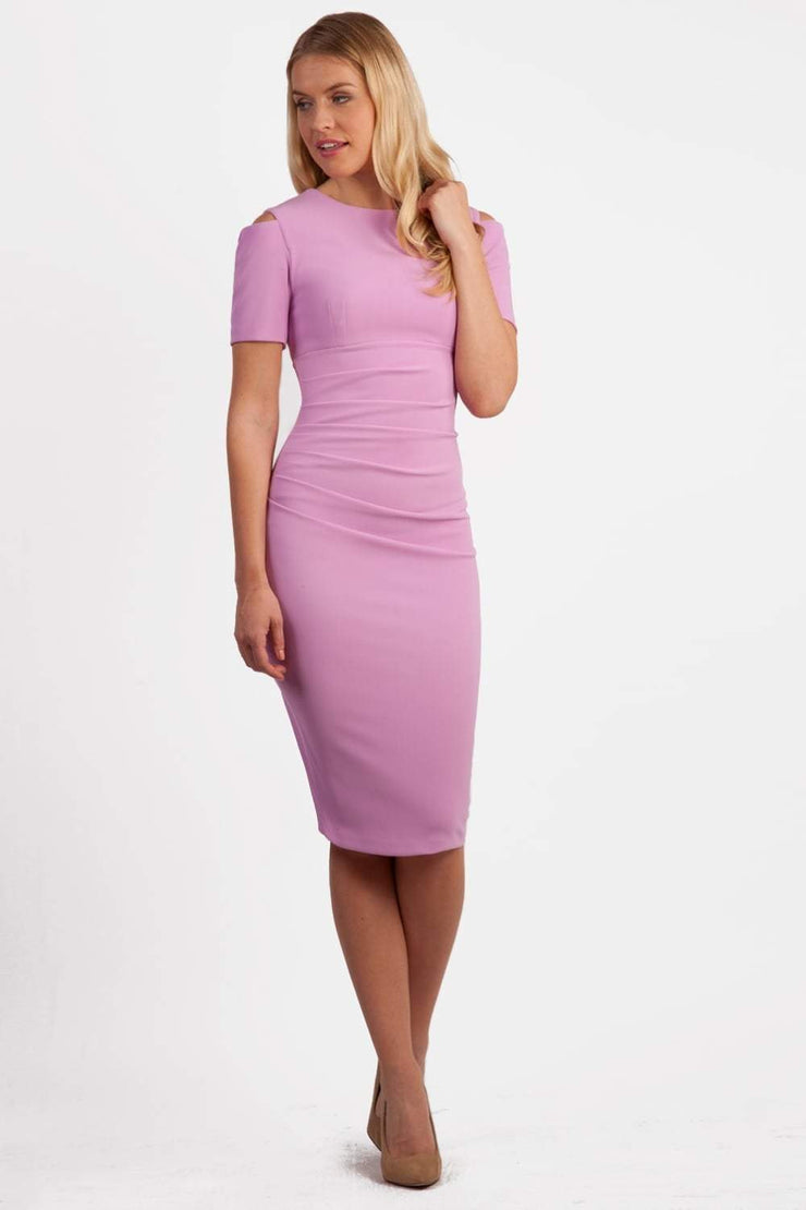 Model wearing the Diva Atlas Pencil dress with round neckline short sleeved dress with small cutouts on the shoulders in pearl violet front image