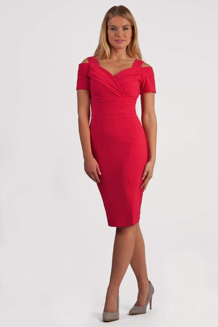 Model wearing the Diva Amorette dress with cold shoulder and pleated detailing on the arms in honeysuckle pink front image