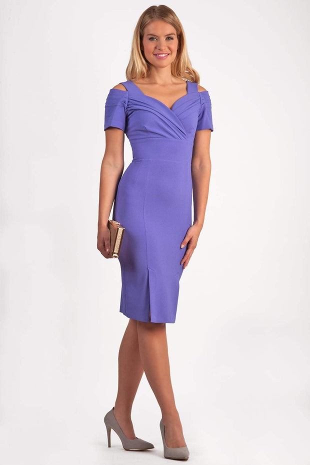 brunette model wearing diva catwalk amorette pencil skirt dress with a cold shoulder detaul and pleating across the bust and slit on a side of skirt in fusion indigo front
