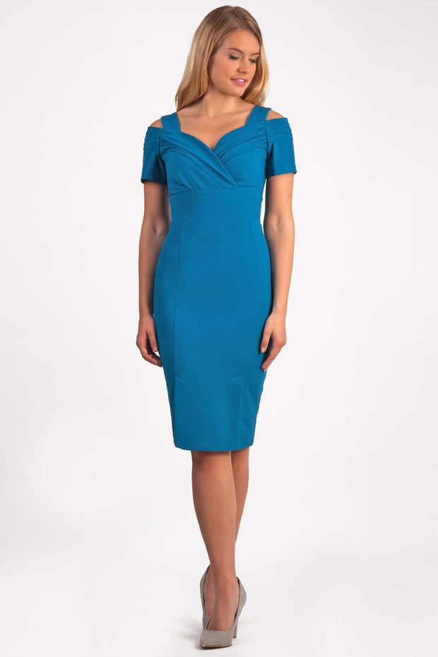brunette model wearing diva catwalk amorette pencil skirt dress with a cold shoulder detaul and pleating across the bust and slit on a side of skirt in tropic teal colour front