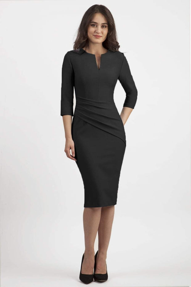 brunette model wearing seed diva catwalk milton sleeved pencil dress with a rounded neckline with a split in the middle in black front