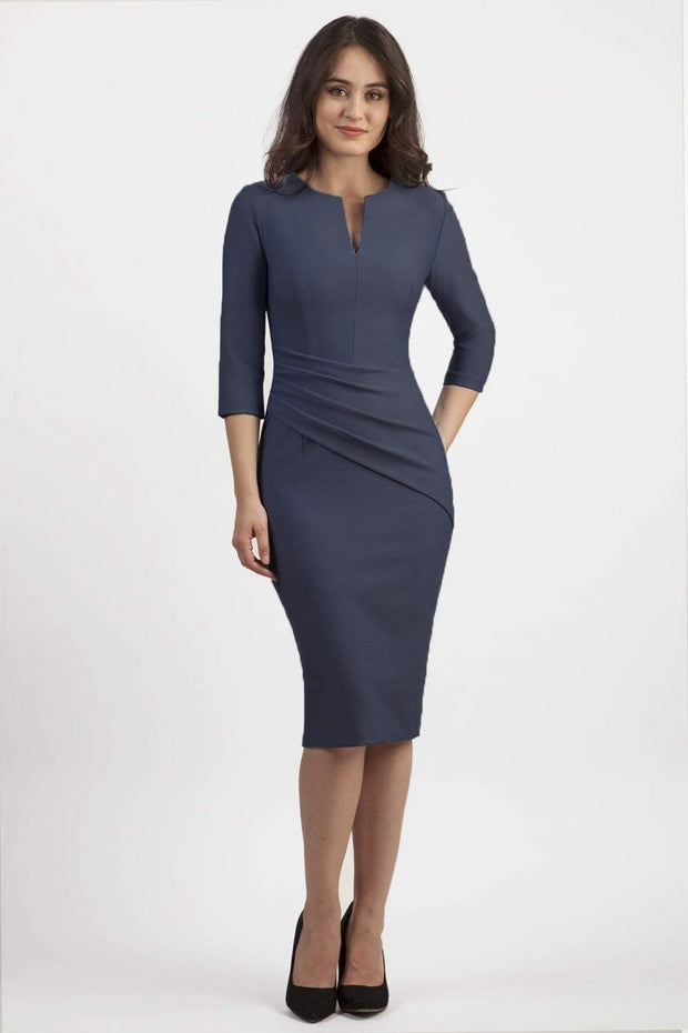 brunette model wearing seed diva catwalk milton sleeved pencil dress with a rounded neckline with a split in the middle in slate grey front