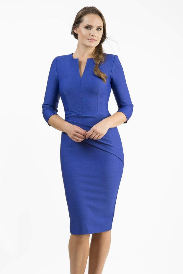 brunette model wearing seed diva catwalk milton sleeved pencil dress with a rounded neckline with a split in the middle in monaco blue front