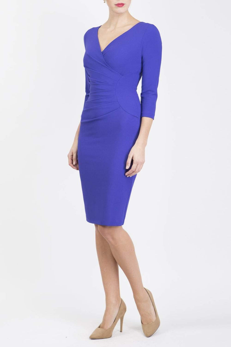 Model wearing the Diva Chelsea Pencil dress with V neckline and three-quarter sleeves in spectrum indigo front image