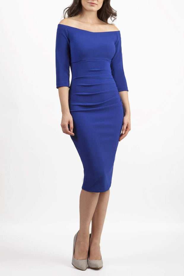 Model wearing the Diva Astra pencil dress with off shoulder design in cobalt blue front image