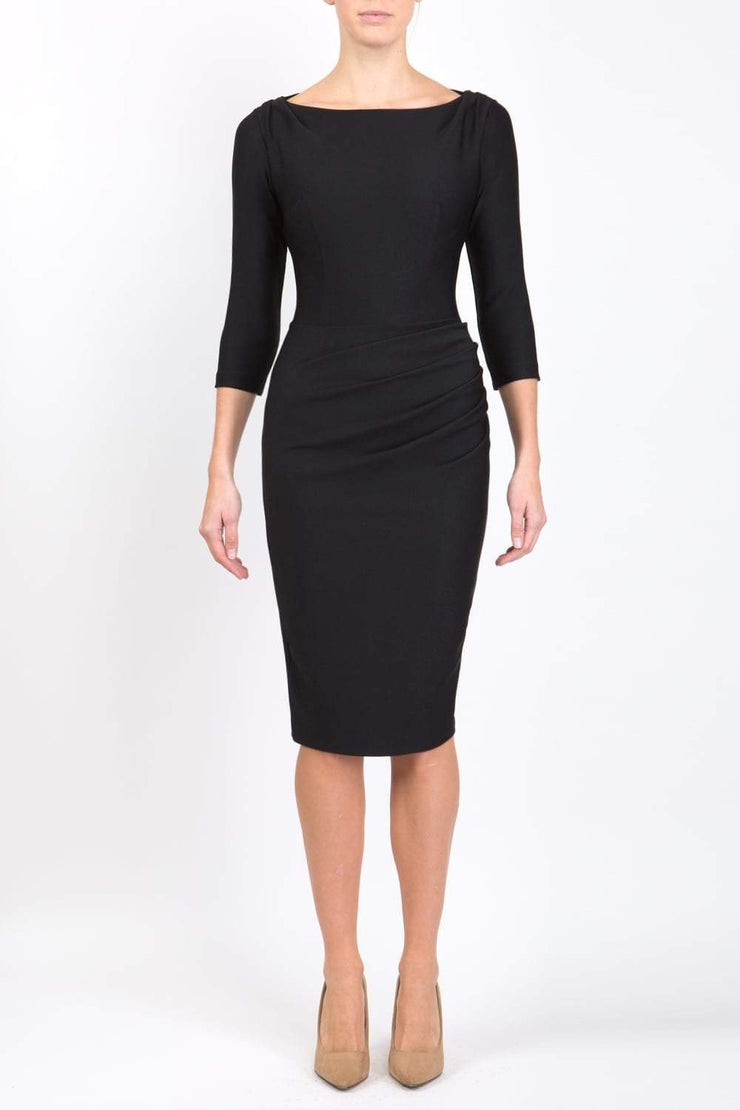 Model wearing the Seed Agatha in pencil dress design in black front image