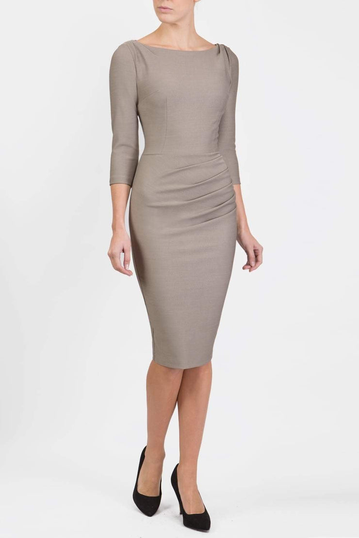 Model wearing the Seed Agatha in pencil dress design in taupe brown image