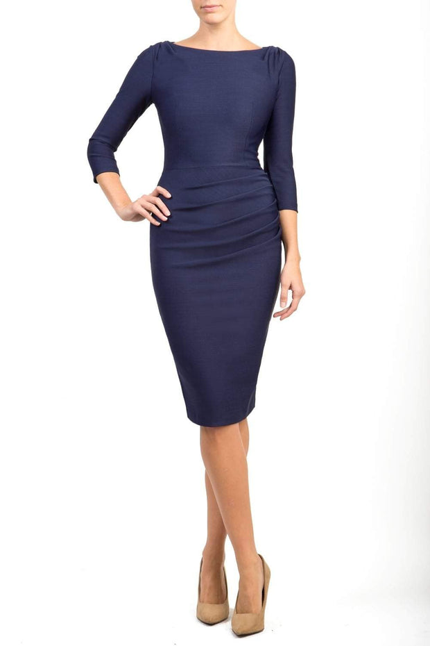 Model wearing the Seed Agatha in pencil dress design in navy front image