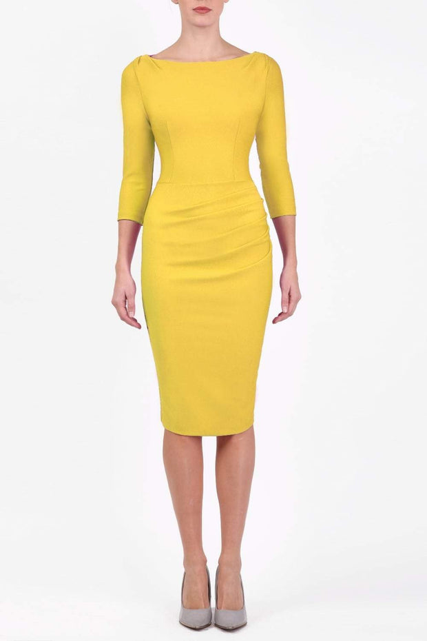 Model wearing the Seed Agatha in pencil dress design in daffodil yellow front image