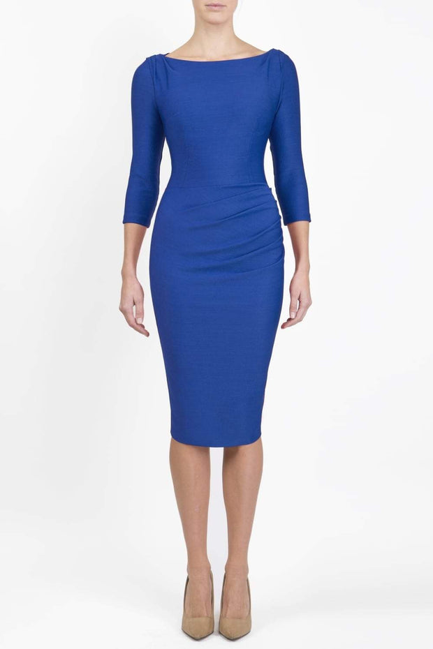 Model wearing the Seed Agatha in pencil dress design in cobalt blue front image