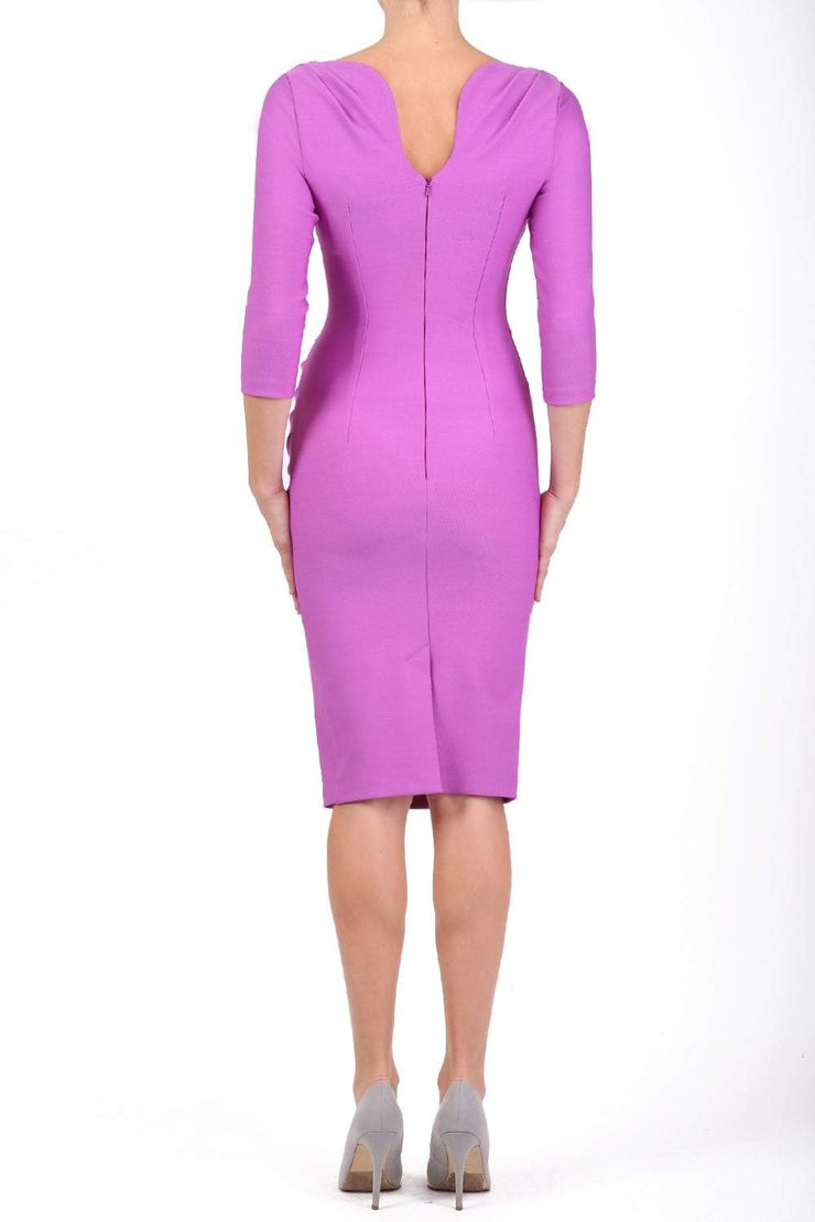 Model wearing the Seed Agatha in pencil dress design in magenta mist back image