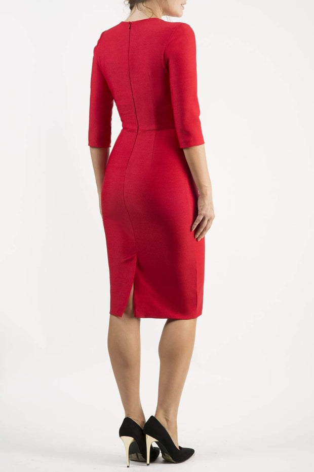 brunette model wearing seed diva catwalk milton sleeved pencil dress with a rounded neckline with a split in the middle in salsa red back