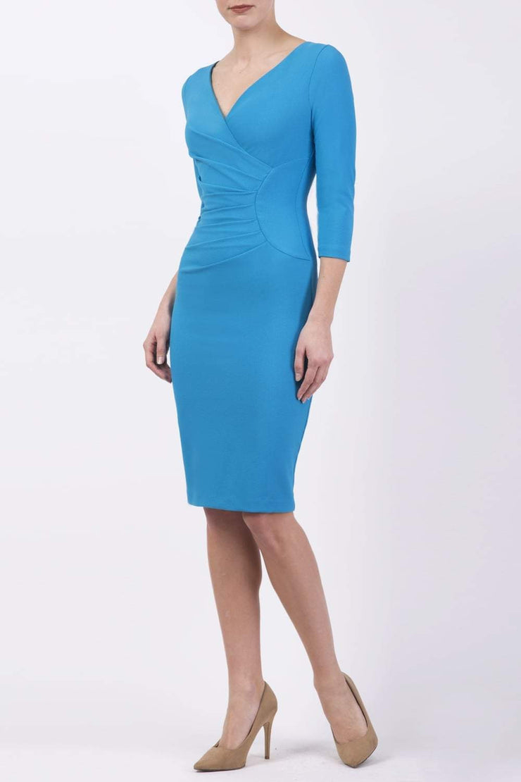 Model wearing the Diva Chelsea Pencil dress with V neckline and three-quarter sleeves in topaz front image