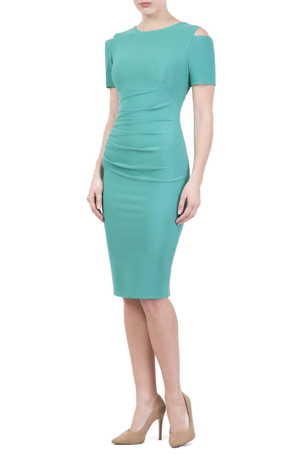 Model wearing the Diva Atlas Pencil dress with round neckline short sleeved dress with small cutouts on the shoulders in emerald green front image