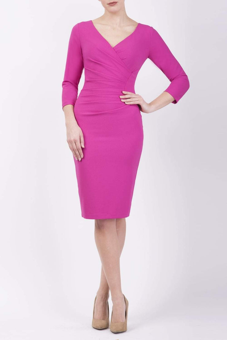 Model wearing the Diva Chelsea Pencil dress with V neckline and three-quarter sleeves in fushia pink front image