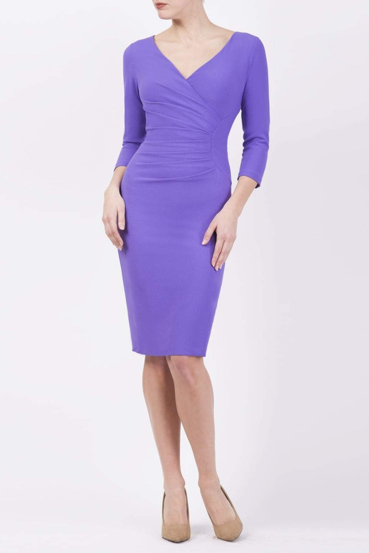 Model wearing the Diva Chelsea Pencil dress with V neckline and three-quarter sleeves in opulent violet front image