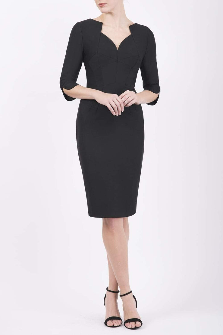 model wearing seed couture zara pencil skirt dress in black colour with asymmetric neckline with sleeves front