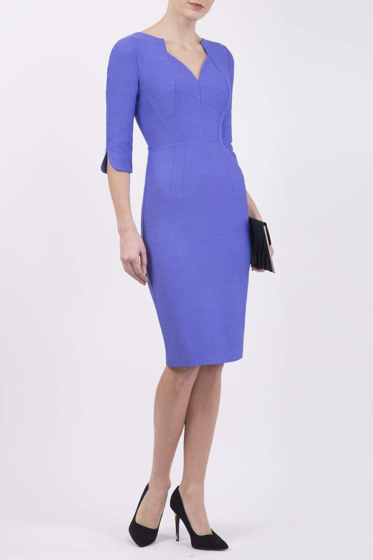 model wearing seed couture zara pencil skirt dress in dawn purple with asymmetric neckline with sleeves front
