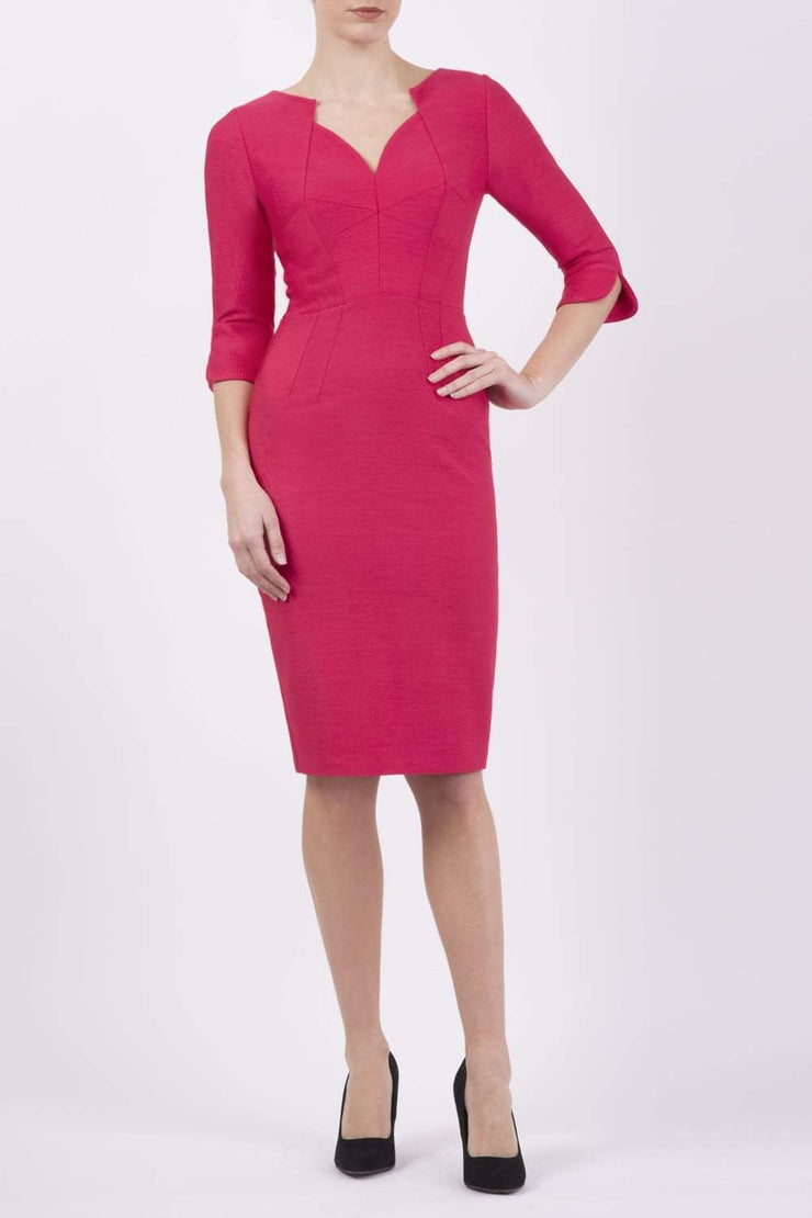 model wearing seed couture zara pencil skirt dress in pink with asymmetric neckline with sleeves front