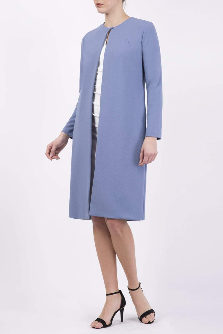Model wearing the Diva Bliss Coat with round neckline in Stone Blue front image