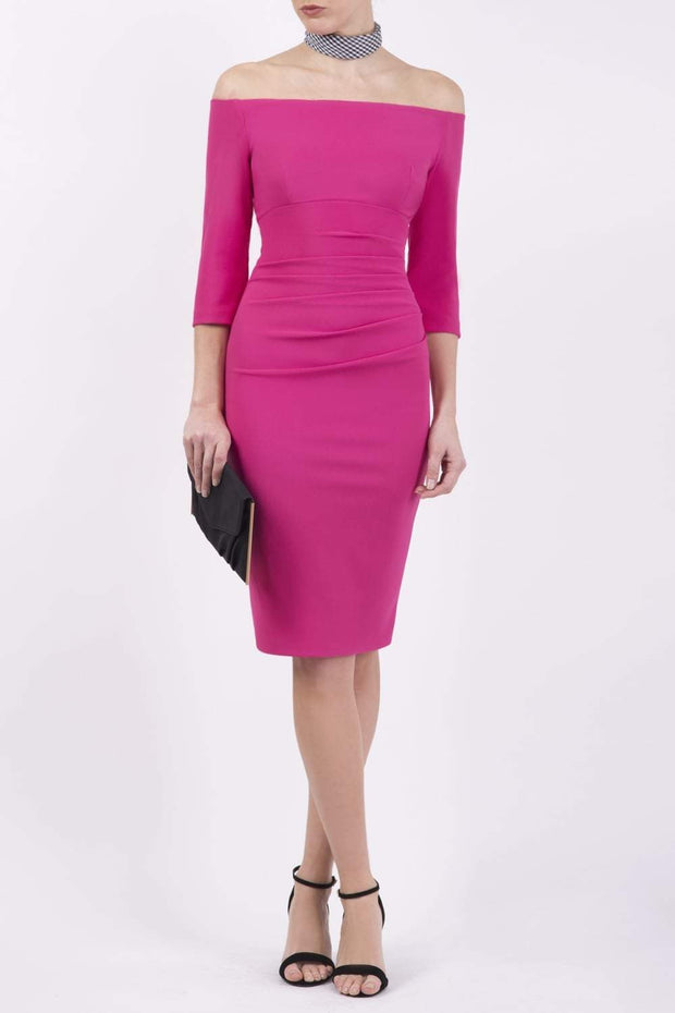 Model wearing the Diva Astra pencil dress with off shoulder design in ottoman fushia pink front image