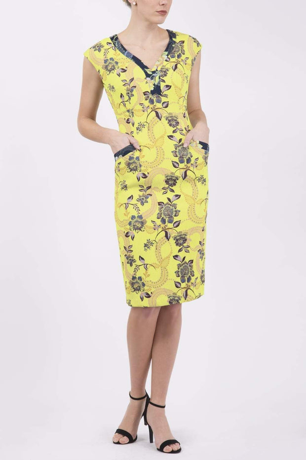 Model wearing the Diva Adeline Shift dress with V-neckline with a trim in Citronelle Green front image