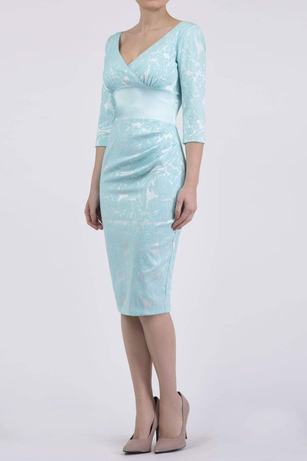 Model wearing the Diva Stamford Satin dress in pencil dress design in turquoise front image