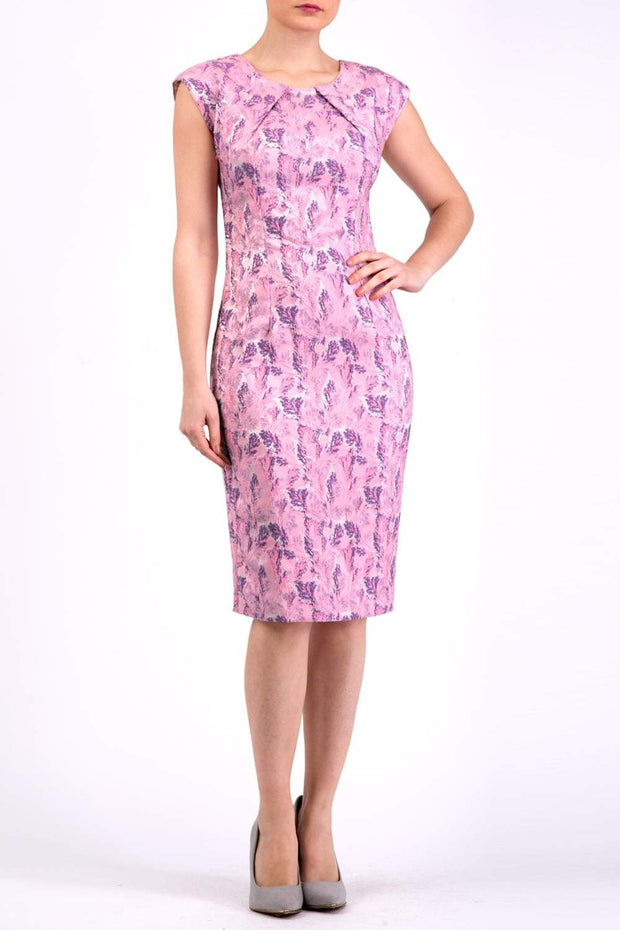 Model wearing the Diva Vera Floral dress in pencil dress design in pink lavender colour front image
