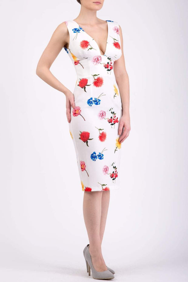 Model wearing the Diva Athens Print dress sleeveless with plunging neckline, semi square open back in buttercup print front image