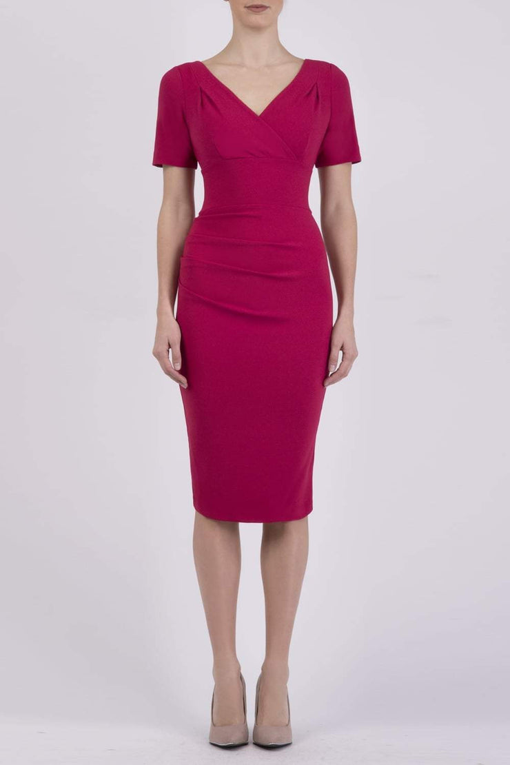 Model wearing the Diva Opal dress in pencil dress design in dazzle pink front image