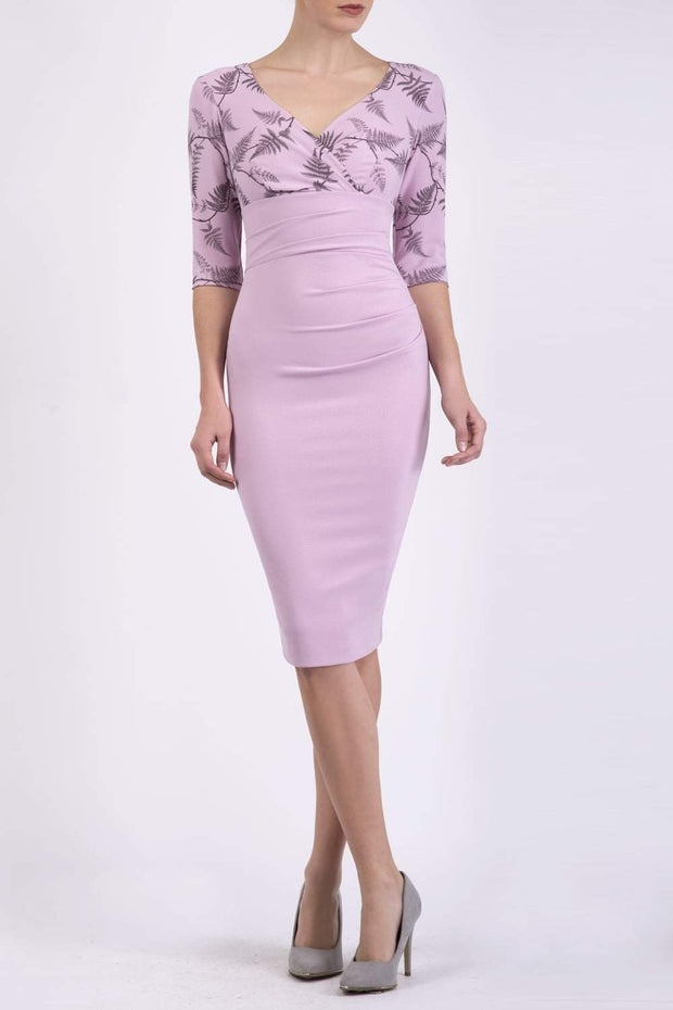 Model wearing the Diva Cynthia Print Contrast dress with pleating across the front in dawn pink fern front image