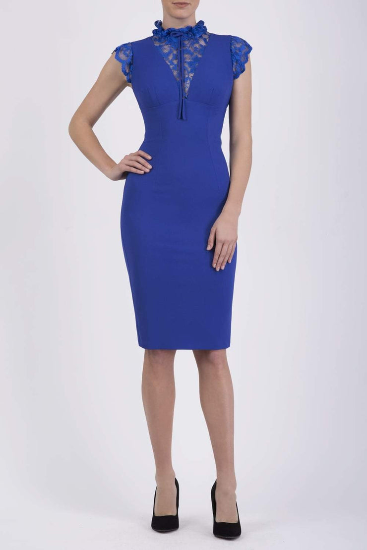 Model wearing the Diva Athens lace pencil dress with gathered lace trim around the neck and shoulder edges in riviera blue front image