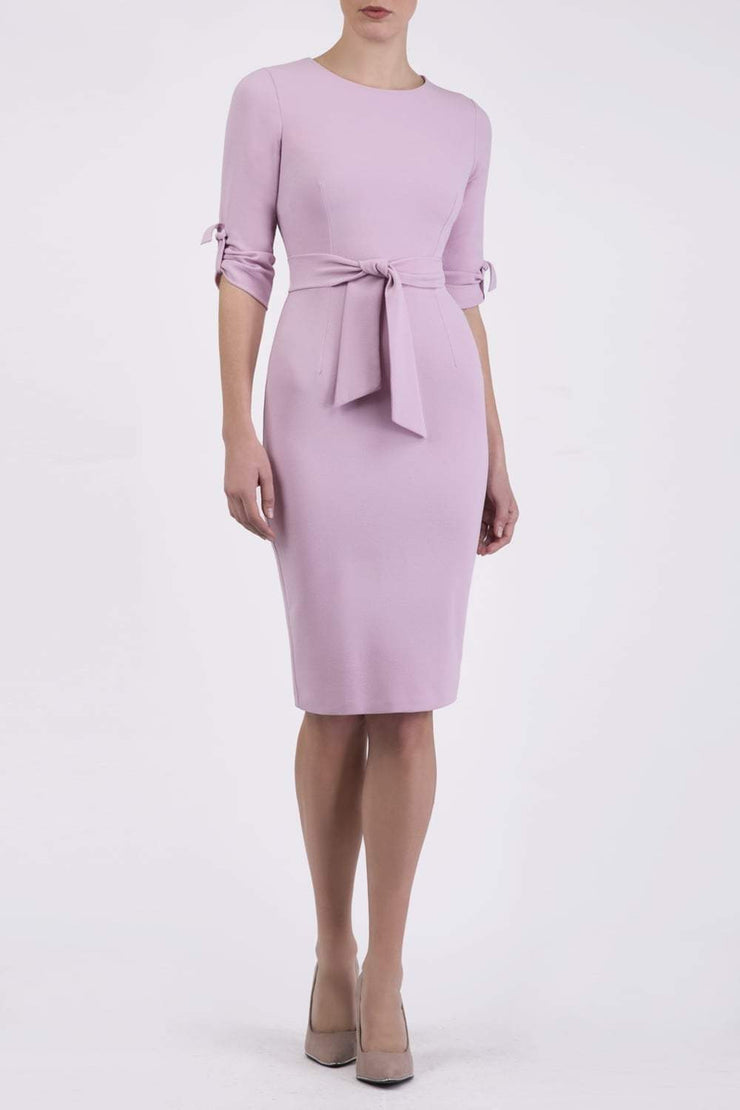 Model wearing the Diva Tryst dress in pencil dress design in dawn pink front image