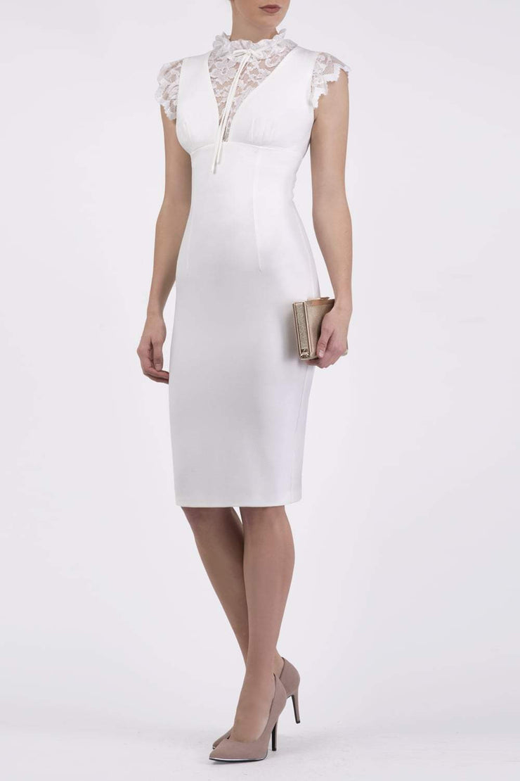 Model wearing the Diva Athens lace pencil dress with gathered lace trim around the neck and shoulder edges in ivory cream front image