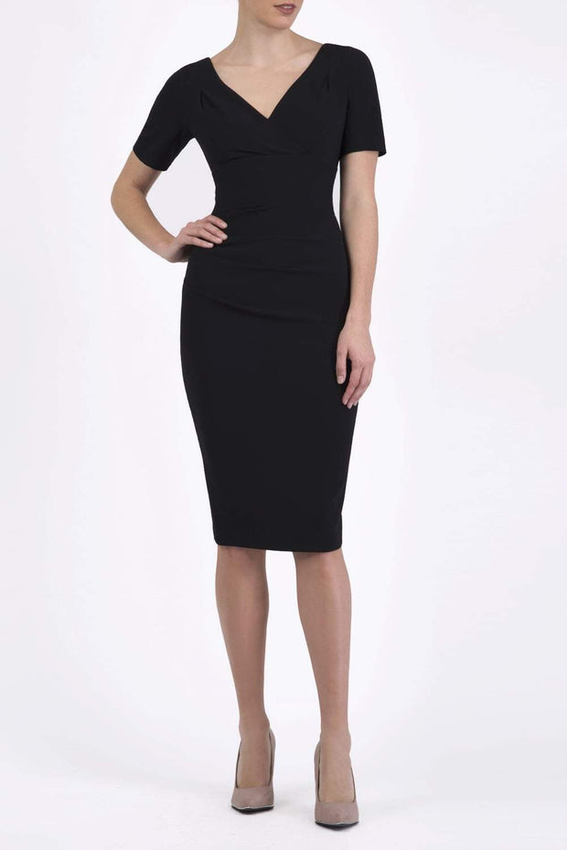 Model wearing the Diva Opal dress in pencil dress design in black front image