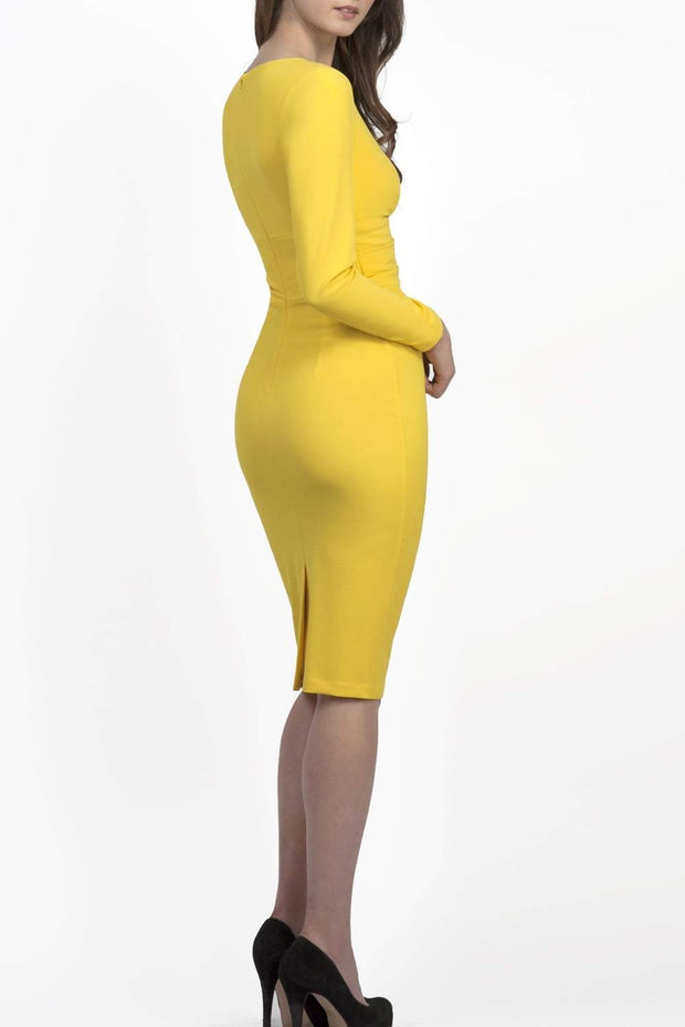 Model wearing the Diva Cynthia Pencil dress with pleating across the front in freesia yellow front image