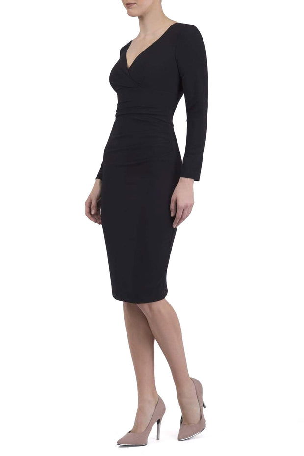 Model wearing the Diva Cynthia Pencil dress with pleating across the front in black front image