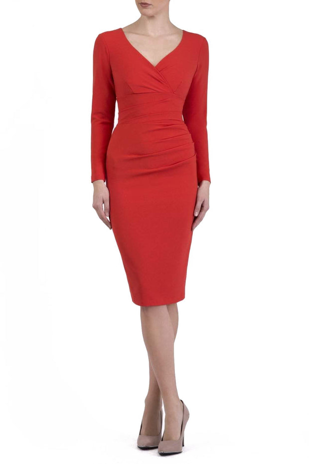 Model wearing the Diva Cynthia Pencil dress with pleating across the front in fiesta orange front image