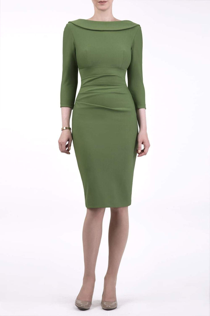 model wearing diva catwalk york pencil-skirt dress with sleeves and rounded folded collar and plearing across the tummy area in vineyard green colour front