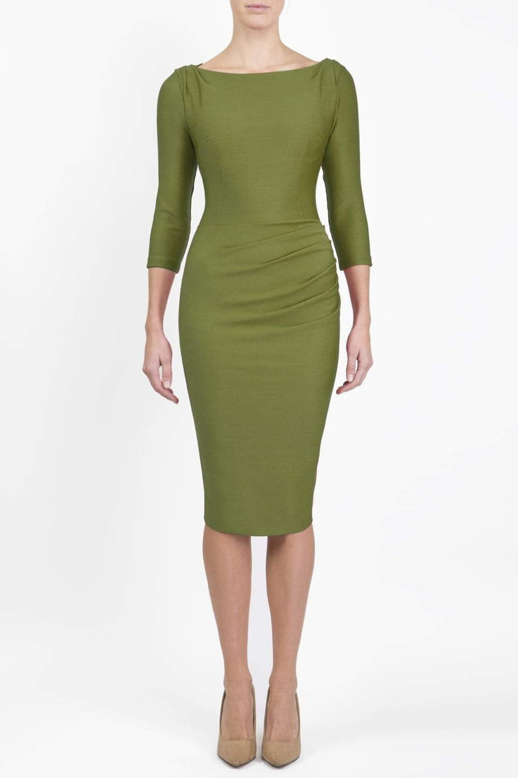 Model wearing the Seed Agatha in pencil dress design in citrus green front image