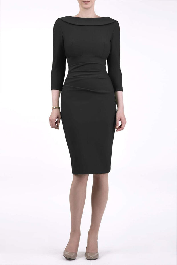 model wearing diva catwalk york pencil-skirt dress with sleeves and rounded folded collar and plearing across the tummy area in black colour front