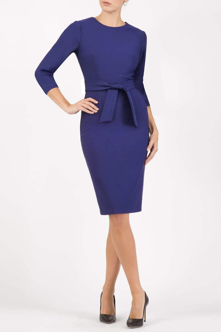 Model wearing the Diva Amatis Pencil dress with round neckline, inserted tie detailing at the front in cobalt blue front image