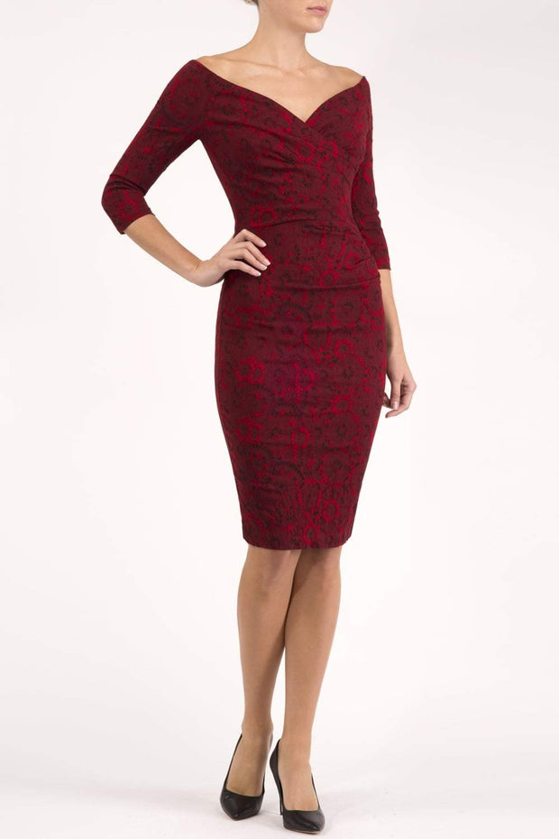 Model wearing the Diva Catherine Jacquard dress with overlapping bodice in circle red front image