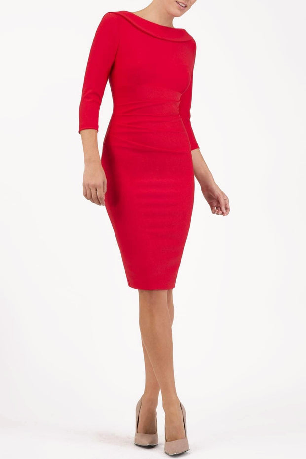 model wearing diva catwalk york pencil-skirt dress with sleeves and rounded folded collar and plearing across the tummy area in red colour front