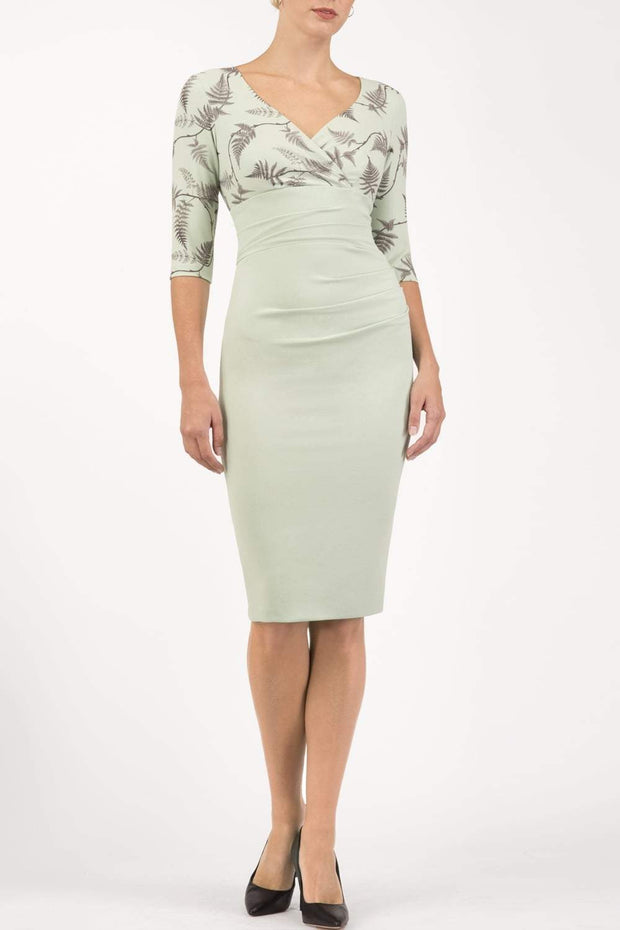 Model wearing the Diva Cynthia Print Contrast dress with pleating across the front in deco green fern front image