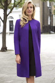 Model wearing the Diva Bliss Coat with round neckline in Spectrum Indigo front image