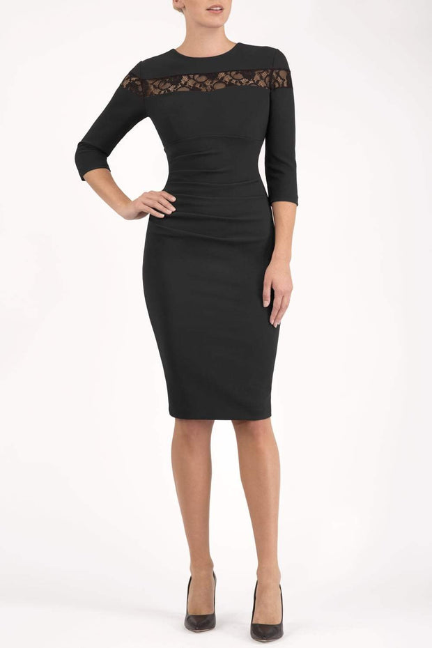 Model wearing the Diva Atlantis Pencil dress with three quarter length sleeves in black and black front image