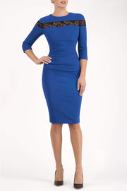Model wearing the Diva Atlantis Pencil dress with three quarter length sleeves in cobalt blue and black front image